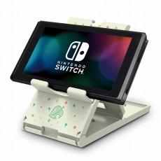 Ein neues Zubehör, eine Halterung im Animal Crossing-Design ist abgebildet. Auf ihr hat ohne Probleme eine Nintendo Switch Platz. Sie ist faltbar. Die Halterung ist weiß.