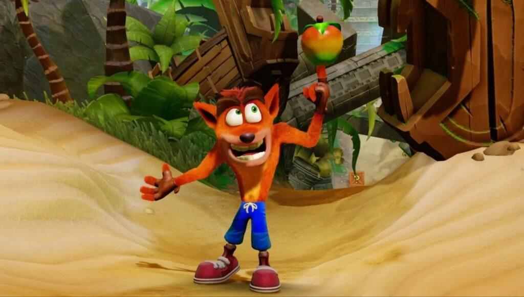 Das Bild zeigt den vermutlich sechsten DLC-Kämpfer Crash Bandicoot, wie er einen Apfel auf einem Finger jongliert.