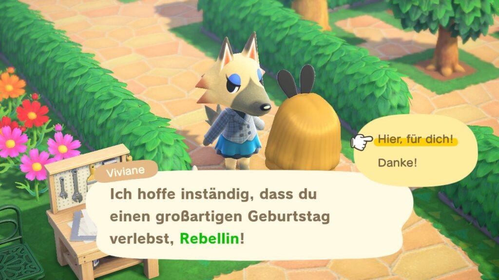 """das Bild zeigt eine Unterhaltung mit einem Bewohner in """"Animal Crossing: New Horizon""""."""